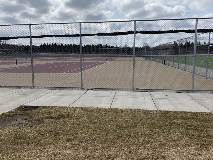 Tennis courts, which are usually filled with flying balls around the court, has no movement to be seen after school was cancelled.