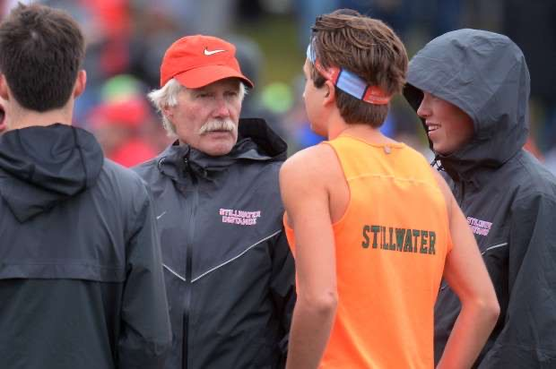 Stillwater coach Scott Christensen and runner Ethan Vargas stand alongside at a meet. The relationship between a coach and an athlete is very important for the races and meets.