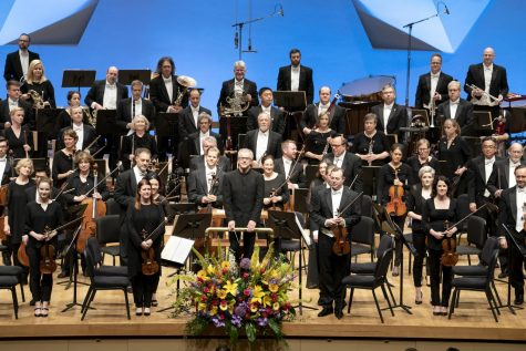 The Minnesota Orchestra stands for applause after performing Gustav Mahler's