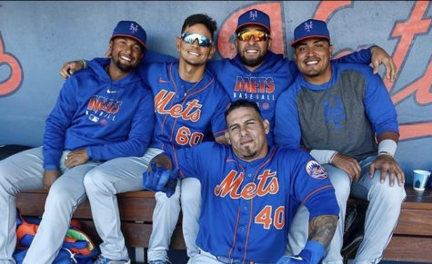 New York Mets player Wilson Ramos poses with his teammates on Feb. 29. The person taking the photo is Anthony Causi, a beloved sports photographer who died on Apr. 12 from Covid-19.