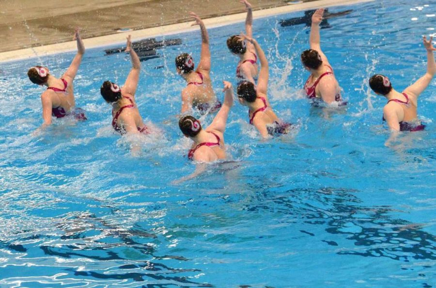 Junior Rubie Ballantyne competes with other members of the synchronized swimming team. The team hopes to win state this year.