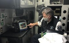 Every morning, paramedics check the ambulance. Wade Watson checks the monitor and does a defibrillator test to ensure it is working properly.