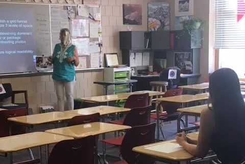 Yearbook and Journalism teacher Laurie Hansen teaches her third hour class. She is wearing both a face shield and a mask in order to help stop the spread of COVID-19. Face masks are now required in all school buildings by the Minnesota Department of Health.