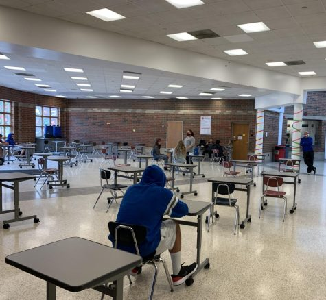 This is the new seating arrangement in the cafeteria for the 2020 school year. The cafeteria looks very quiet and empty due to the individual desks and the reduced number of students attending to lunch.