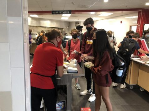 Juniors at Stillwater Area High School, Amelia Bretl, Nick Koehn and Connor Quaderer take advantage of the free lunches provided due to COVID-19. Each student can receive one entree but must take one serving of fruits or vegetables.