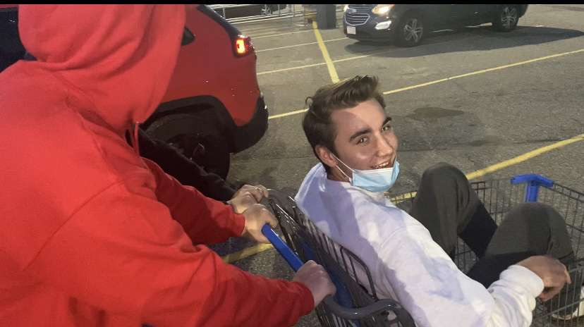 """Seniors Joey Lottsfeldt and Paul Wenzel filming in the Wallmart parking lot for Lottsfeldt's new video. The video being filmed is the """"we got kicked out of Walmart"""" video which received around 200 views."""