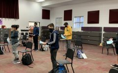 Students of the Freshmen Mens Choir join together to rehearse their music. Although they are wearing masks and six feet apart, they still can be together and create music through this pandemic.