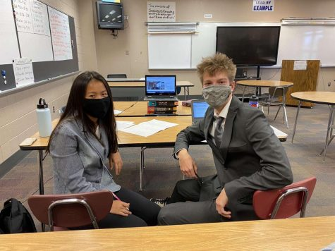 Soren Gabor and Amelia Bretl participate in their first online debate competition.