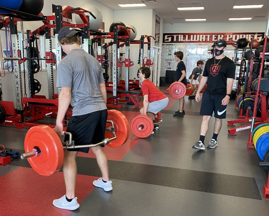 Derrick Schmidt, ETS Performance coach, Ethan Mosley, Bo Dustin, Brendan Bernier and Ethan Bernier, run a safe and productive workout.