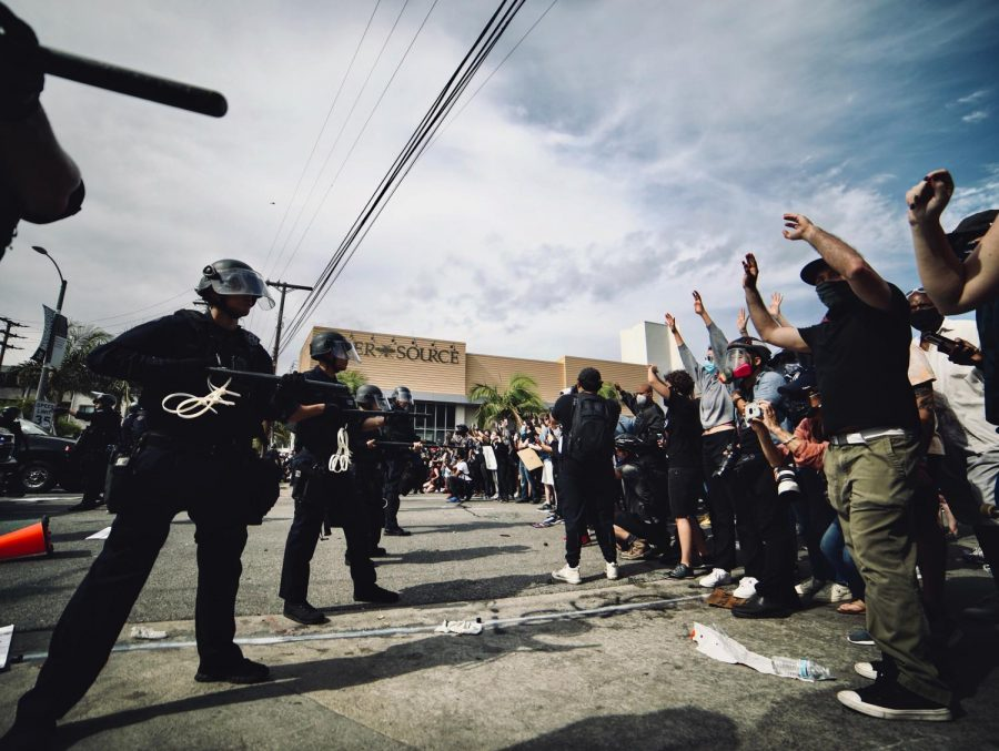 Peaceful Black Lives Matter protesters in Los Angeles stand together in the faces of law enforcement. A number of protests have emerged in prominent cities in response to the killing of George Floyd in the summer of 2020.
