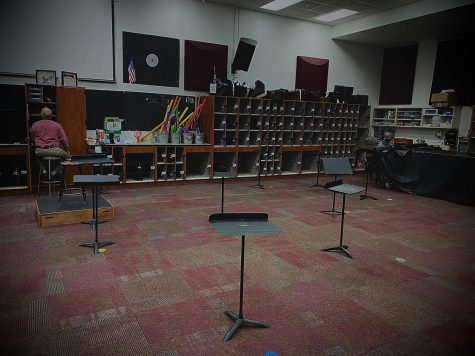 """This photo shows band teacher Dennis Lindsay along with his one in-person student for Percussion Ensemble on the b day. A room that would usually be filled with around 30 students playing a variety of instruments, from Marimbas to Tom Toms, instead only shows one student and Lindsay doing their """"independent studies"""" while the stands and chairs (not pictured) sit with no one using them during this period. Many of the students in Percussion Ensemble are doing full on distance learning, and in early November with the start of quarter two, this room will be left fully empty."""