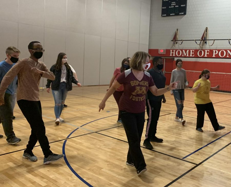 Paula Harrison and the Unified class follow along to a dance video. Dancing is one of the many activities students enjoy together in this class.