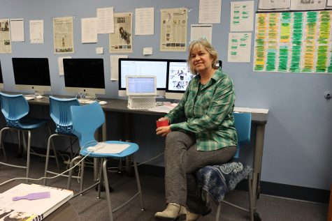 Yearbook advisor Laurie Hansen runs three different computers all at the same time. One has the design program, the other has a database to look up student contacts, and the small laptop is for emailing yearbook staff.