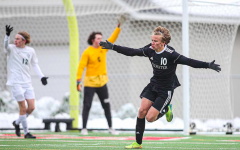 Junior Riley Buxell celebrates his winning goal for the section championship against Park. This win was just one of many for the boys soccer team, unfortunately they will not get the chance to compete for a state title.