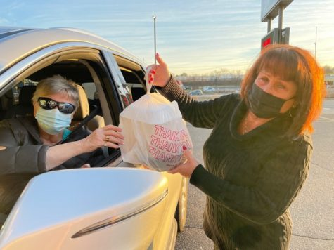 A Joseph's customer (left) is having her food for curbside pickup handed to her by Mary Kohler (right) of Joseph's. Many will recognize this situation, as curbside pickup has become a more popular way of ordering food from restaurants in the time of the pandemic.