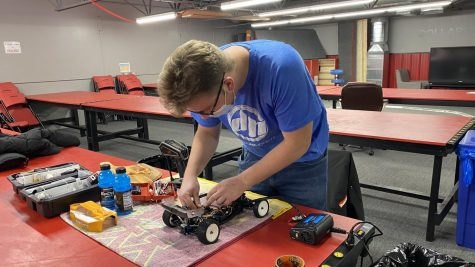 Senior Isaac Bursch changes a gear in his RC car. He spent nearly five hours practicing, and modifying for his Jan. 15 race.