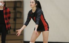 Senior Joelle Carpenter on the court in an away match versus Park High school, down and ready for a pass in one of the last games on the season.