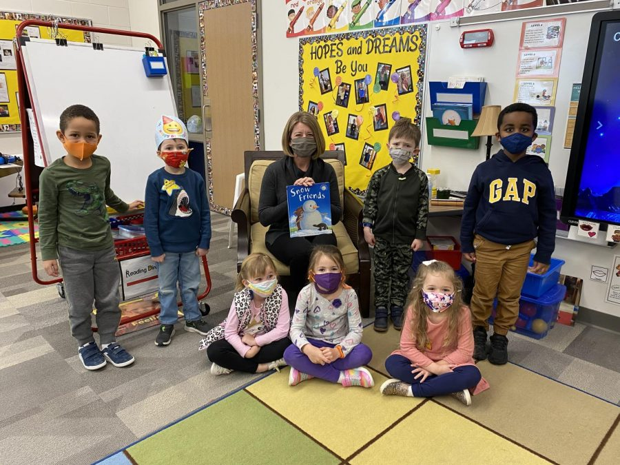 Gina Doe, the new Interim Principal at Brookview Elementary reads to the Pre-schoolers, as she gets to know the students.