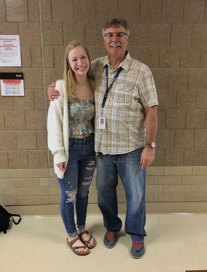 Teacher Mike Kaul is standing beside his former student Mallory McKay.