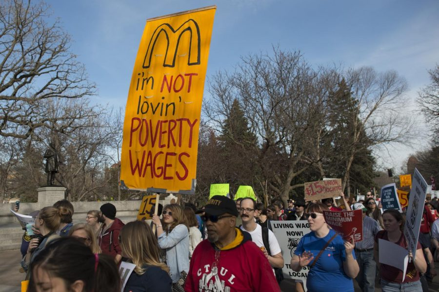 Minimum wage employees go on strike for a $15 minimum wage in Dinkytown, 2015. President Joe Biden has made promises to meet this demand by 2025.
