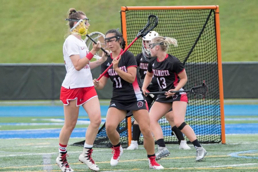 Girls+lacrosse+faces+Lakeville+North+in+the+State+Quarterfinal+of+the+2019+season.+This+was+the+last+in-person+season+as+their+2020+year+was+canceled+due+to+COVID-19.+