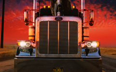 This is Bad Bunny's album cover of truck with a red and sky with stars background.