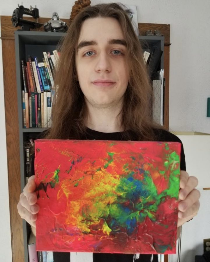 "Junior Jackson Duin shows off one of his favorite paintings titled ""Light Up The Day."" Duin recently curated an exhibition at Art Reach St. Croix, the youngest to do so at the gallery."