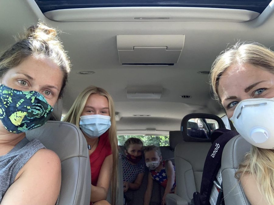 Molly O'shea and her neighbors are seen following the guidelines and wearing a mask when 6 feet is not accessible. She is still able to be social while maintaining the guidelines.