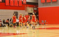 Seniors Gionna Carr and Alexis Pratt, junior Amber Scalia, sophomore Lexi Karlen and freshman Amy Thompson communicate during a game.