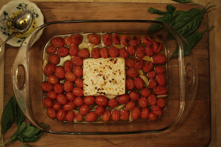 TikTok famous feta pasta fresh out of the oven just before the noodles are added. The next step is to mix together the baked and broiled feta, tomatoes and garlic.