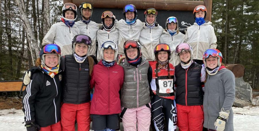 The+boys+and+girls+alpine+teams+group+together+for+a+final+team+picture+after+the+Minnesota+High+School+State+Meet.+Three+of+the+boys+and+four+of+the+girls+skiers+pictured+will+be+returning+for+next+season.+