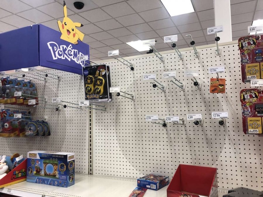 These are unstocked store shelves at a local target. These hooks are normally filled with packs of Pokémon cards, but now sit empty the majority of the time.