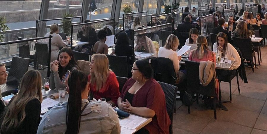 Union Rooftop Bar and Grill in downtown Minneapolis on March 26. Because of the COVID-19 pandemic, there are plexiglass barriers between tables, non-reusable paper menus, and masks are to be worn by all staff and customers when not actively eating or drinking.