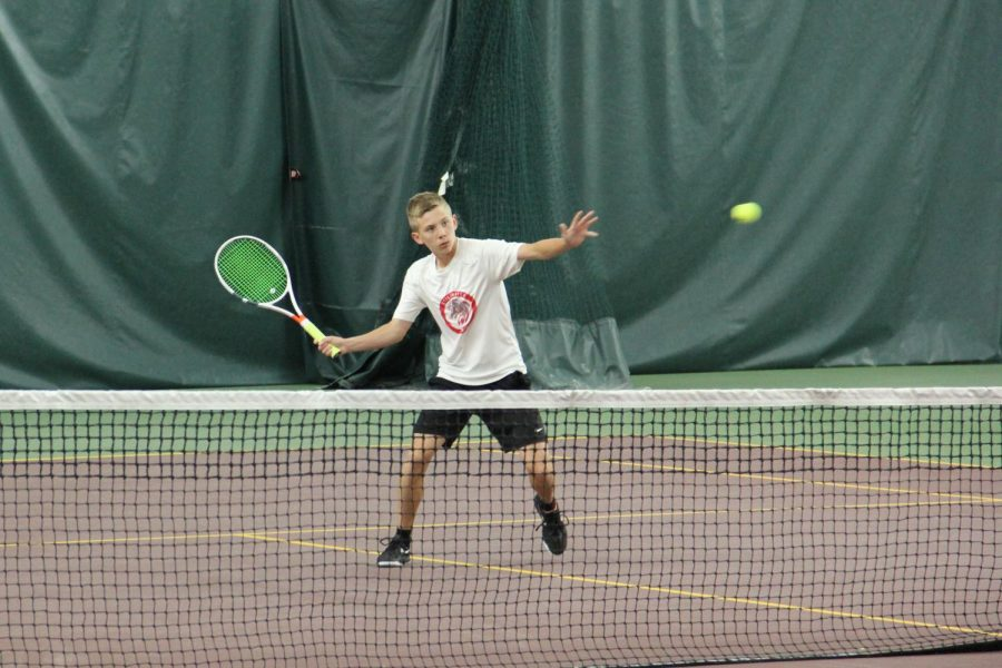 Junior Dylan Magistad playing tennis his freshman year, the last real season the boys were able to have due to COVID-19.