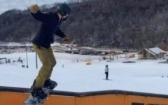 Senior Carson Arco snowboards on a box at Afton Alps Resort