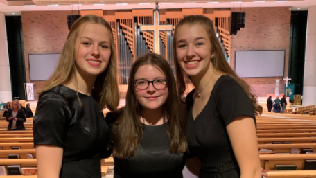 Then-sophomores Marena Saeger, Josie Crombie, and Carley Saeger perform at their last choir concert before COVID-19 became a global pandemic, during November of 2019.