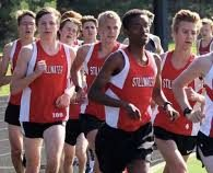 Boys track season is another spring sport that will be greatly affected by COVID-19. These track and field players will have to wear a mask at all times as well.