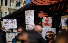 Demonstrators hold up signs at a protest in San Francisco. Rallies advocating for Asian lives have appeared in many major cities across the country, as anti-Asian hate crimes are increasing.