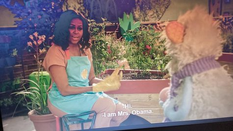 Previous First Lady Michelle Obama sits beside an animated stuffed animal, Mochi, as a new Netflix TV series captures the adventures of food and travel in a kid friendly way.