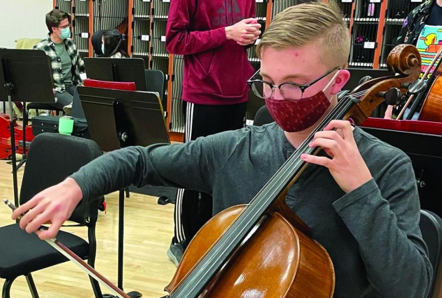 Senior Alex Steil works on his homework during class. He also practices cello before Con Amici rehersal.
