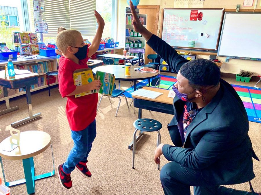 Dr. Christopher Rogers, who will be Brookview Elementary School's new principal in the 2021-2022 school year, visits classrooms and exchanges air high fives during his first day as interim principal at Afton-Lakeland Elementary in the 2020-2021 school year.