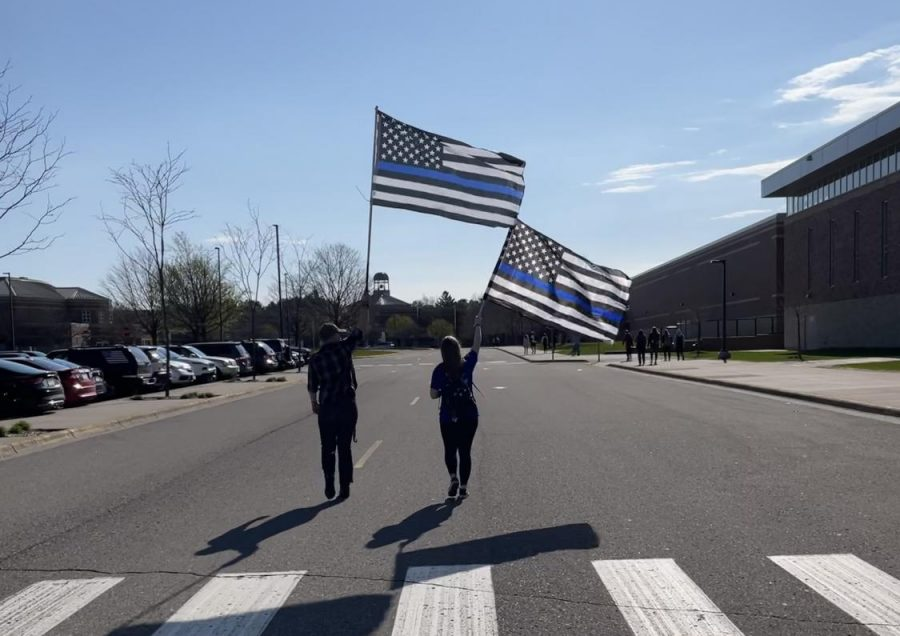 Local high school students hold thin blue line flags during a Back the Blue walkout. Thin blue line flags are seen as support to law enforcement and a sign of respect for those who sacrificed their lives.