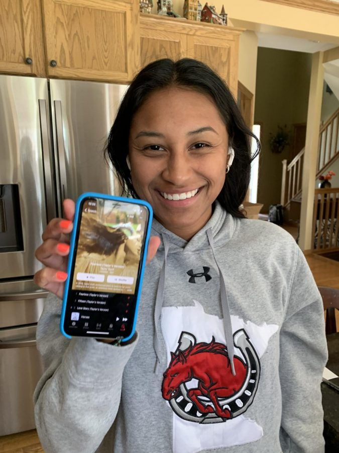 Junior Mayona Jones listens to Taylor Swifts Fearless (Taylors Version).