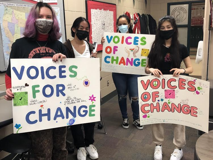 Students+create+posters+to+promote+the+Voices+of+Change+virtual+conference.+These+posters+were+put+around+the+school+to+encourage+students+to+attend.+
