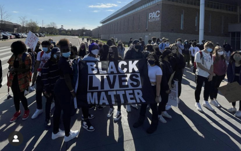 Students participate in the walk out at the high school. Students bring posters and flags to state their opinion.
