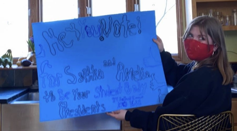 Junior Eliza Weston helps make posters for Sophia Pietan and Amelia Bretl's campaign for student council Presidents of the upcoming school year. Pietan and Bretl also used buttons, social media and other platforms to spread the news about voting for them.