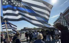 Students gathered outside of the high school to support law enforcement, while they held thin blue line flags. Counter-protesters stood across from them, and they held a flag along with cardboard signs.