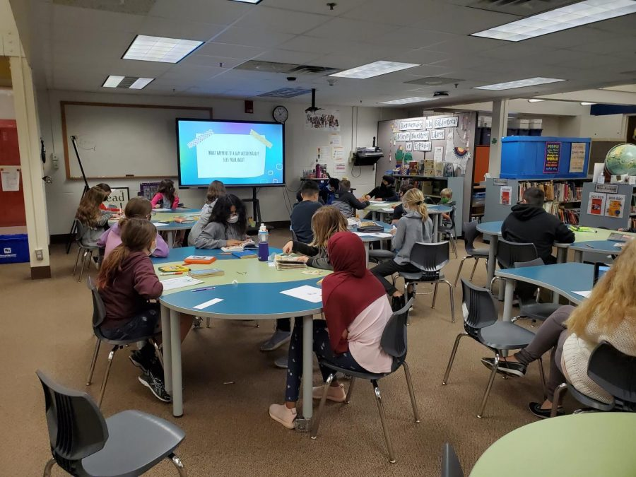 Lake Elmo Elementary students gather in the media center to watch Shahd Abouhekel's video. The students were able to learn about Muslim culture as well as interact with one another.