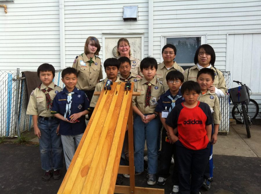 (Photo Credit:  Shannon VerDuin) The photo features VerDuin and her daughter alongside a Hmong Cub Scout pack she had started back in Wausau, Wisconsin.  With this group of kids, VerDuin made memories she cherishes to this day doing arts and crafts with her scouts and helping them feel comfortable with her open arms.