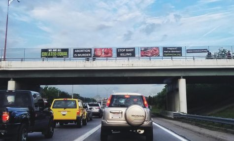 Political signage line an overhead bridge in Columbus, Ohio. Many other bridges like this one on I-70 hold the same view of political signs on abortion.